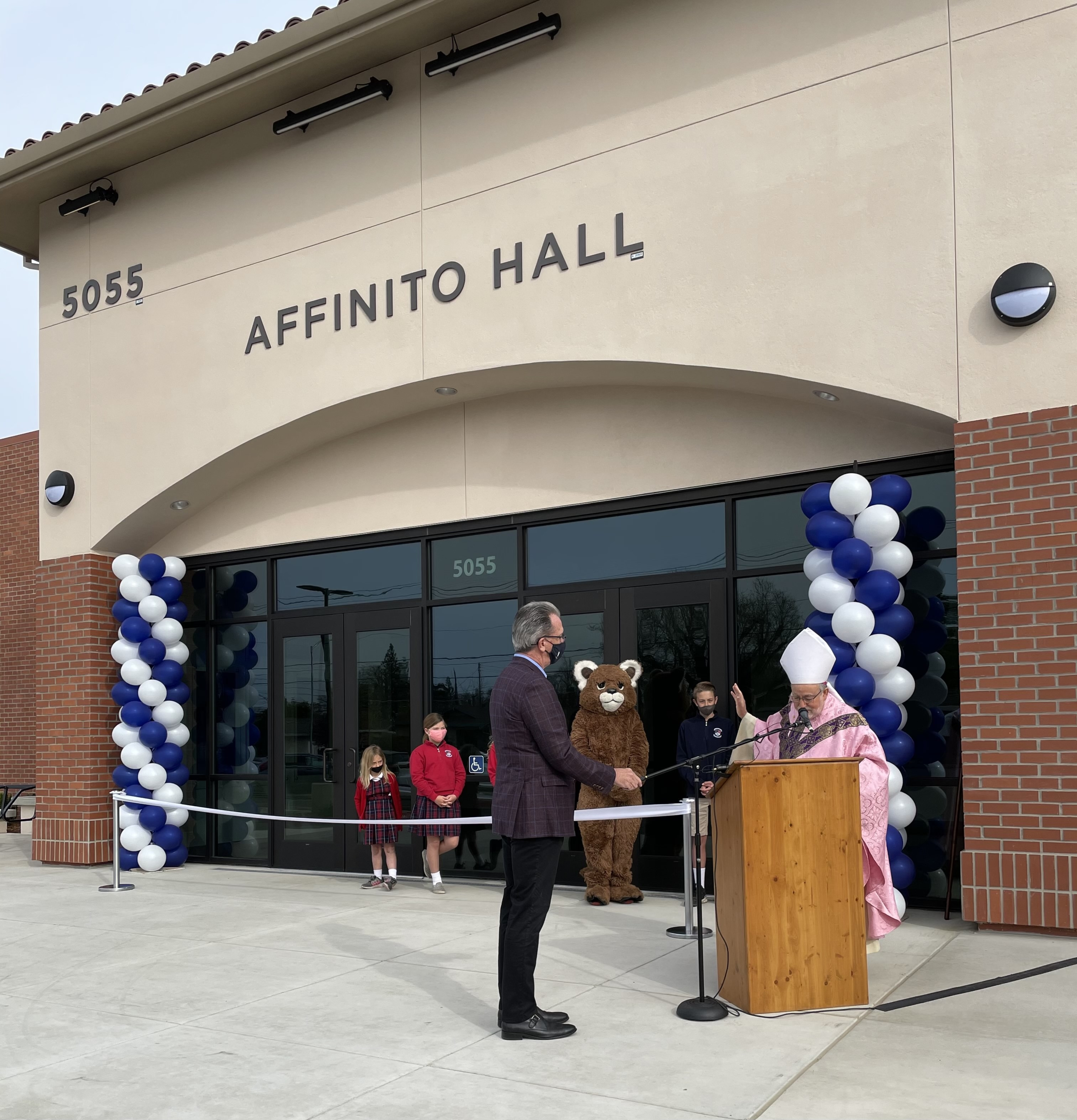 Bishop Soto blesses Affinito Hall.