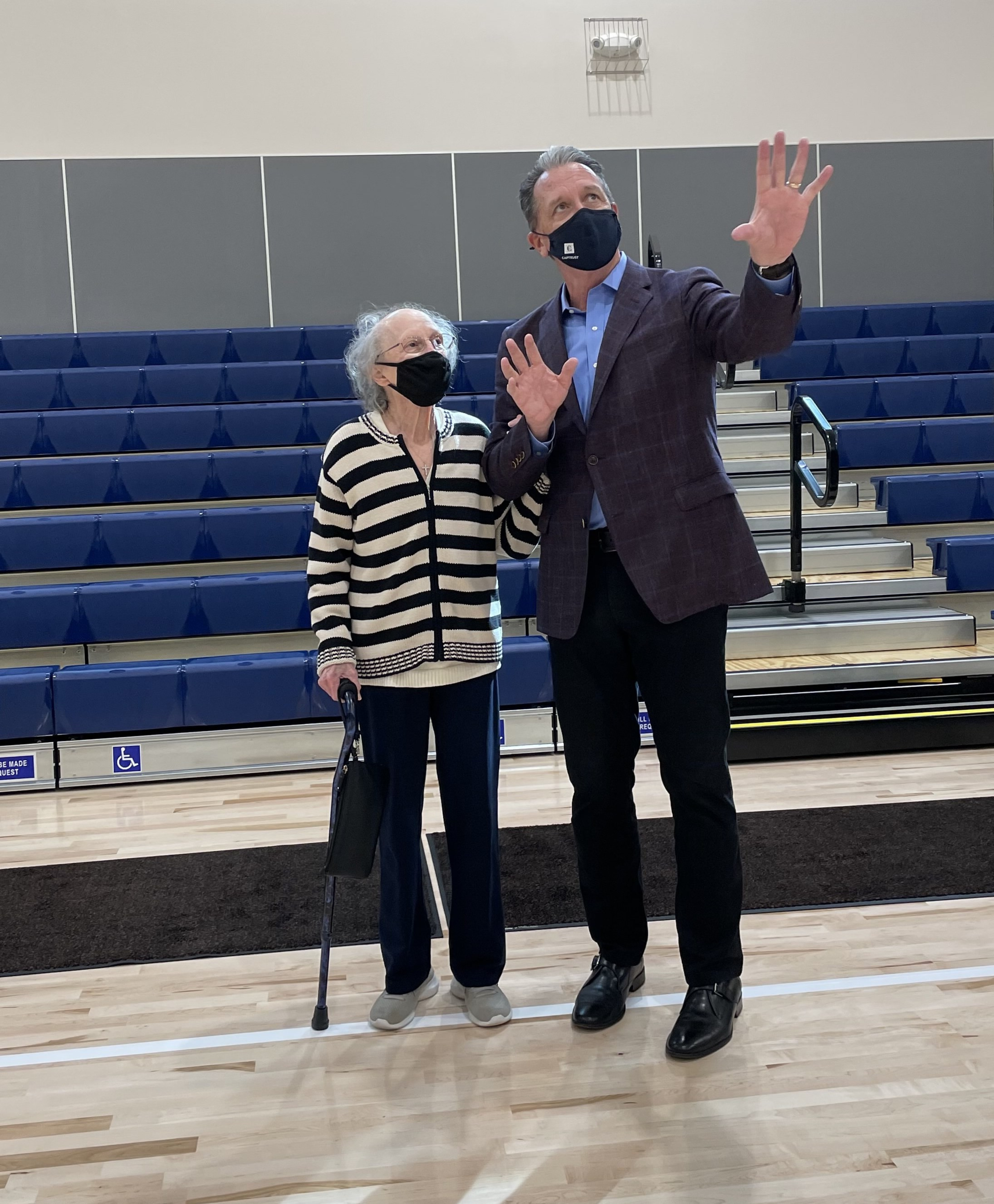 Kelly Brothers and Nancy Affinito admire the new gym and stage.